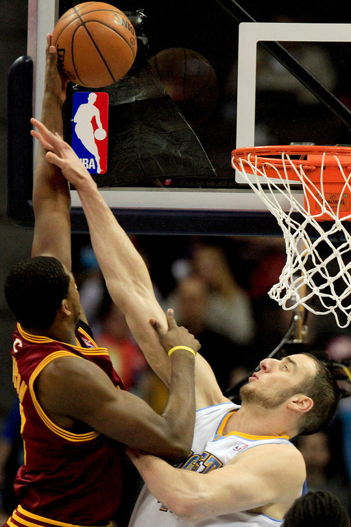 . Denver Nuggets\' Kosta Koufos, right, fouls Cleveland Cavaliers\' Tristan Thompson left, who scored the basket during the first quarter of an NBA basketball game Friday, Jan. 11, 2013, in Denver. (AP Photo/Barry Gutierrez)