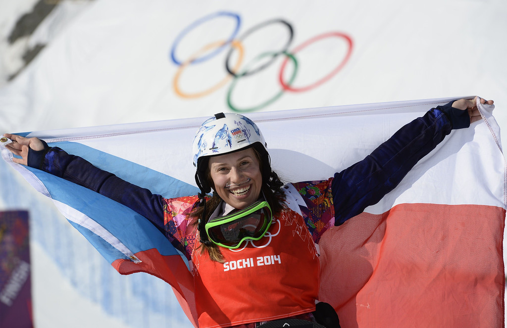 . Gold Medallist, Czech Republic\'s Eva Samkova celebrates during the Women\'s Snowboard Cross Flower Ceremony at the Rosa Khutor Extreme Park during the Sochi Winter Olympics on February 16, 2014.   FRANCK FIFE/AFP/Getty Images