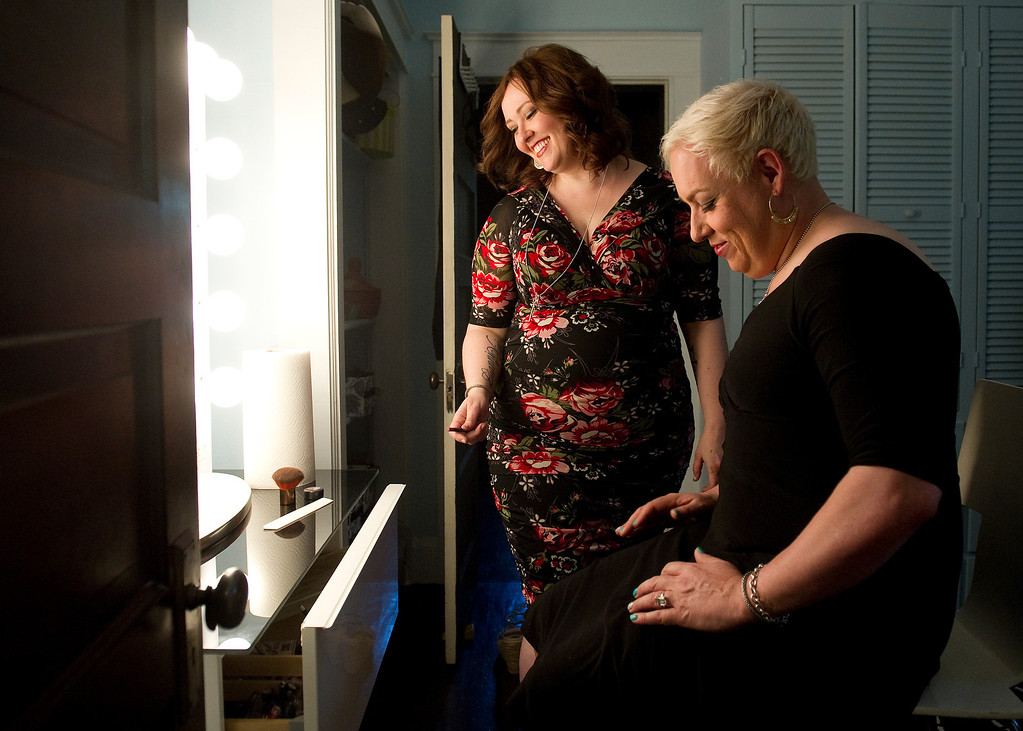. Sara , left, and Koko Brentano  on  Monday, June 3, 2013 at their photo studio and makeup space. Sara is a divorcee and mother of two who is getting ready to marry Koko, who identifies as a woman but has not had gender-change surgery.   (Photo By Cyrus McCrimmon/The Denver Post)