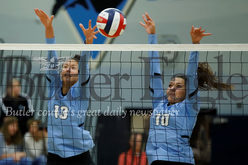 Seneca's Sarah White and Bre Reynolds go for a block over Butler Tuesday. The Raiders topped Butler 3-0. Seb Foltz/Butler Eagle