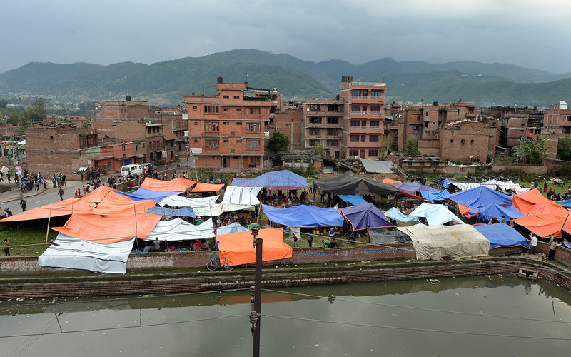 . Nepalese people stay outside in tents in Bhaktapur on the outskirts of Kathmandu on April 26, 2015. International aid groups and governments intensified efforts to get rescuers and supplies into earthquake-hit Nepal on April 26, but severed communications and landslides in the Himalayan nation posed formidable challenges to the relief effort. PRAKASH SINGH/AFP/Getty Images