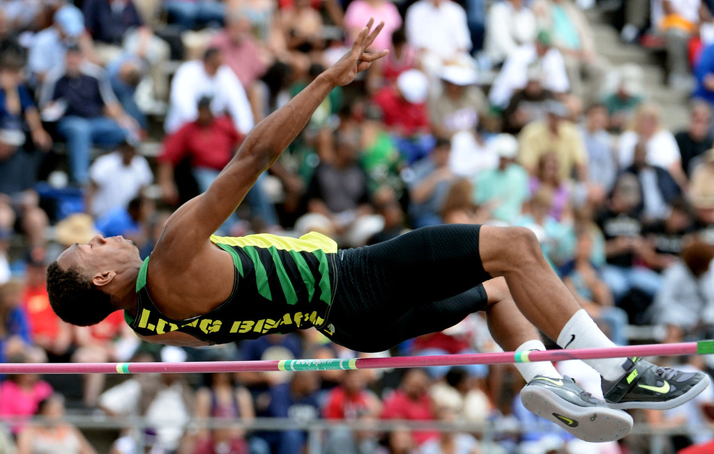 . Long Beach Poly\'s LaBrice Howard competes in the division 1 high jump during the CIF Southern Section track and final Championships at Cerritos College in Norwalk, Calif., Saturday, May 24, 2014.   (Keith Birmingham/Pasadena Star-News)