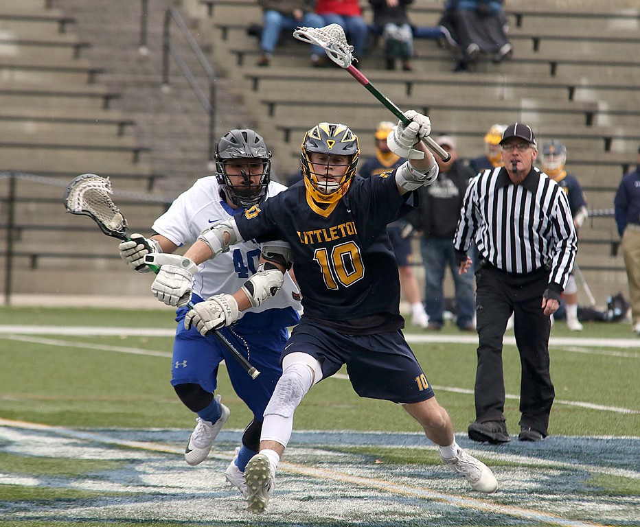 . Leominster High School boys lacrosse played Littleton High School today at Doyle Field in Leominster. Littleton\'s Gavin Bergeron gets a hold of the ball followed by Leominster\'s Tyrese Perez during action in the game. SENTINEL & ENTERPRISE/JOHN LOVE