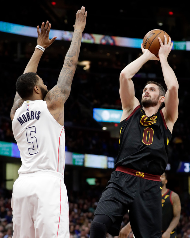 . Cleveland Cavaliers\' Kevin Love (0) shoots over Washington Wizards\' Markieff Morris (5) in the first half of an NBA basketball game, Thursday, April 5, 2018, in Cleveland. (AP Photo/Tony Dejak)