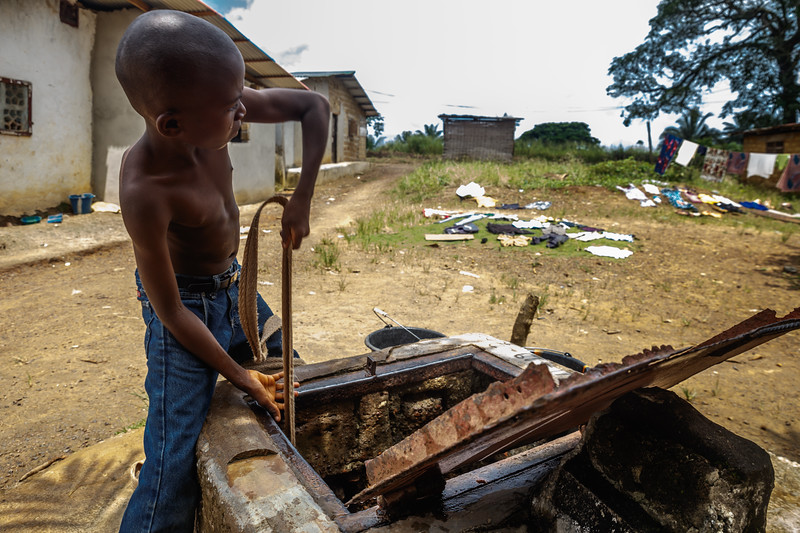 Monrovia, Liberia October 8, 2017 -  A young boy pulls water from a well.