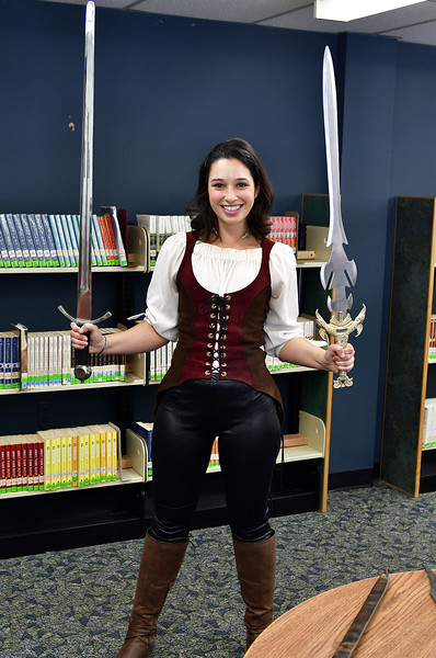 11/10/2018 Mike Orazzi | Staff Southington Children's Librarian Molly Virello holds one of the items on display during a Renaissance Faire held at the Southington Public Library Saturday.