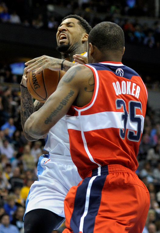 . DENVER, CO - JANUARY 18: Washington forward Trevor Booker tied up Wilson Chandler in the first half. The Denver Nuggets hosted the Washington Wizard at the Pepsi Center Friday night, January 18, 2013. Karl Gehring/The Denver Post