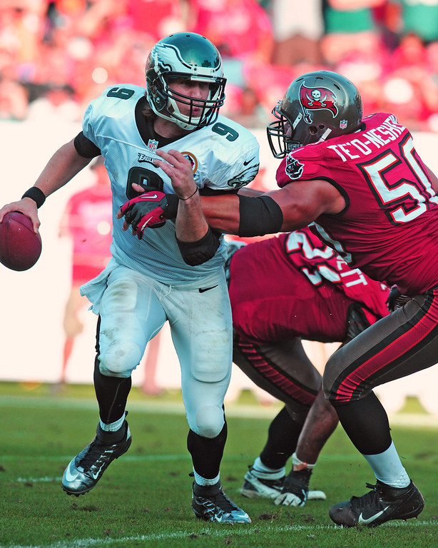 . TAMPA, FL - DECEMBER 9: Quarterback Nick Foles #9 of the Philadelphia Eagles runs away from linebacker Daniel Te\'o-Nesheim #50 of the Tampa Bay Buccaneers December 9, 2012 at Raymond James Stadium in Tampa, Florida.  The Eagles won 23 - 21. (Photo by Al Messerschmidt/Getty Images)