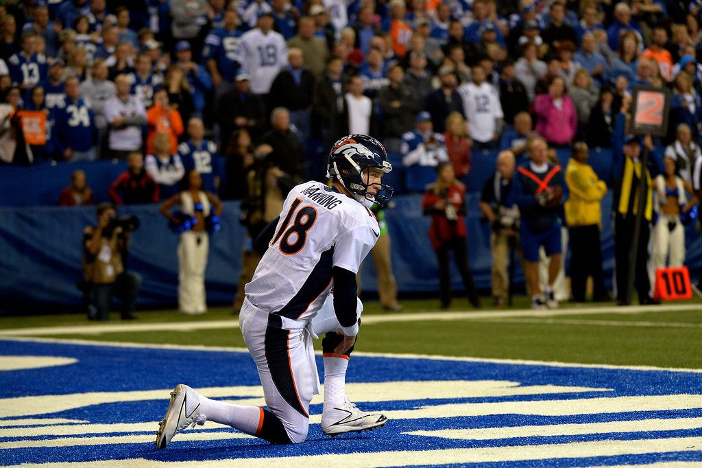 . INDIANAPOLIS, IN. - October 20: Quarterback Peyton Manning (18) of the Denver Broncos climbs to his feet late in the game vs the Indianapolis Colts at Lucas Oil Stadium. October 20, 2013 Indianapolis, Indiana. (Photo By Joe Amon/The Denver Post)