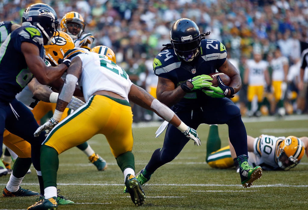 . SEATTLE, WA - SEPTEMBER 04: Running back Marshawn Lynch #24 of the Seattle Seahawks scores a touchdown during the second quarter of the game against the Green Bay Packers at CenturyLink Field on September 4, 2014 in Seattle, Washington.  (Photo by Otto Greule Jr/Getty Images)
