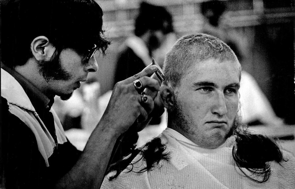 """. John Casey , 18, of Braintree, Mass., is one of 1,525 \""""doolies\"""" (first-year men) who reported for processing this week at the academy near Colorado  Springs. It is largest class in 19-year history of the academy. Casey\'s hair was \""""trimmed \"""" to quarter-inch length. 1973. The Denver Post Library Archive"""