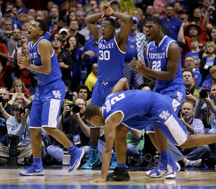 . Kentucky\'s Andrew Harrison (5), Julius Randle (30), Alex Poythress (22) and Aaron Harrison (2) react to a call during the second half of an NCAA Midwest Regional semifinal college basketball tournament game against the Louisville Saturday, March 29, 2014, in Indianapolis. (AP Photo/David J. Phillip)