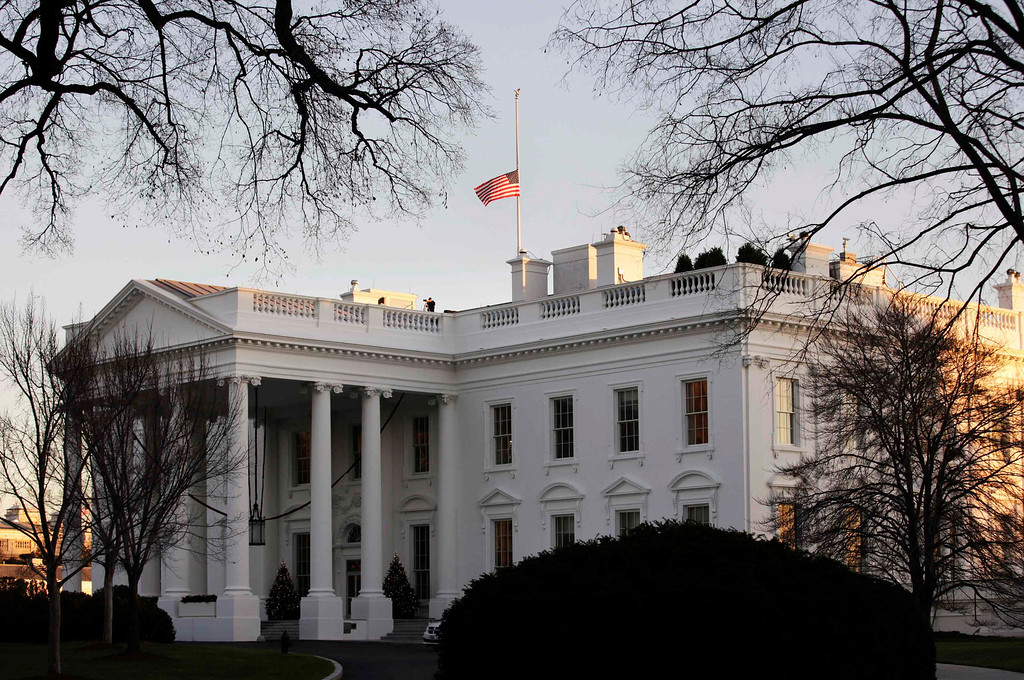". A U.S. flag flies at half-staff at the White House in Washington December 14, 2012. A tearful President Barack Obama expressed ""overwhelming grief\"" on Friday for the victims of a shooting rampage at Sandy Hook Elementary School and called on Americans to set aside politics and take \""meaningful action\"" to prevent further tragedies of this kind. REUTERS/Yuri Gripas"