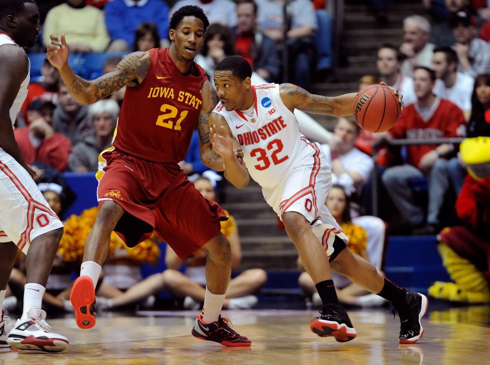 . Lenzelle Smith, Jr. #32 of the Ohio State Buckeyes handles the ball against Will Clyburn #21 of the Iowa State Cyclones in the first half during the third round of the 2013 NCAA Men\'s Basketball Tournament at UD Arena on March 24, 2013 in Dayton, Ohio.  (Photo by Jason Miller/Getty Images)