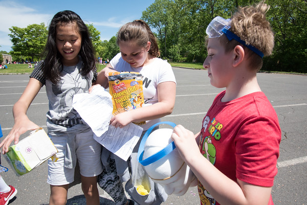 05/21/18 Wesley Bunnell | Staff Bristol Eastern High School students under the leadership of teacher Carolyn Kielma conducted a STEM project with 5th graders from Mountain View School on Monday afternoon involving using protective containers for eggs the 5th graders designed themselves and dropping them from 100ft in the air with the help of Ladder 1 from the Bristol Fire Department. Students check their eggs in the protective containers including Aidan Raboin, R, with his creation egg head.