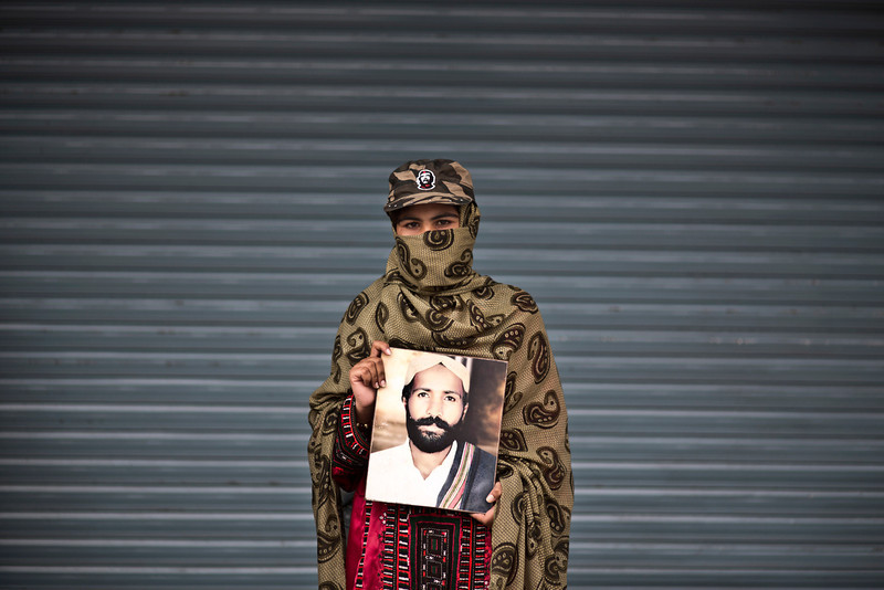 . Sameena Haider, 14, poses for a portrait holding a photograph of her brother, who went missing on August 17, 2013, while she and other relatives take a break from a long march protest, in Rawalpindi, Pakistan, Friday, Feb. 28, 2014. She is part of a group of activists from the impoverished southwestern province of Baluchistan who walked roughly 3,000 kilometers (1,860 miles) to the capital of Islamabad to draw attention to alleged abductions of their loved ones by the Pakistani government. (AP Photo/Muhammed Muheisen)