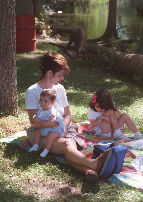 . Kristin Roodbeen picnics with her daughters Jillian ,5 months, and Natalie,4, near the water at Yates Cider Mill in Rochester Hills.