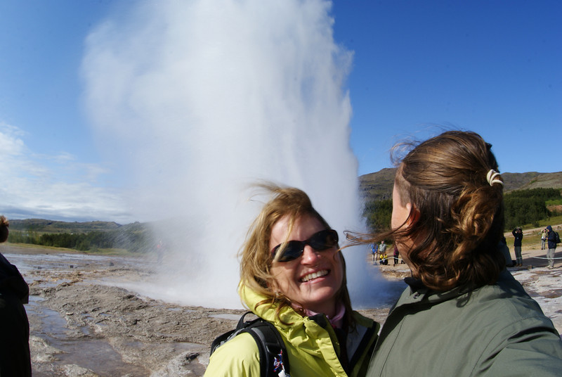 The geyser Geysir erupts on a pretty regular basis.  The Attache missed this erruption because she's so in love with the camera.