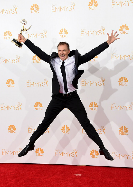 . Host Phil Keoghan, winner of the Outstanding Reality - Competition Program Award for The Amazing Race poses in the press room during the 66th Annual Primetime Emmy Awards held at Nokia Theatre L.A. Live on August 25, 2014 in Los Angeles, California.  (Photo by Jason Merritt/Getty Images)