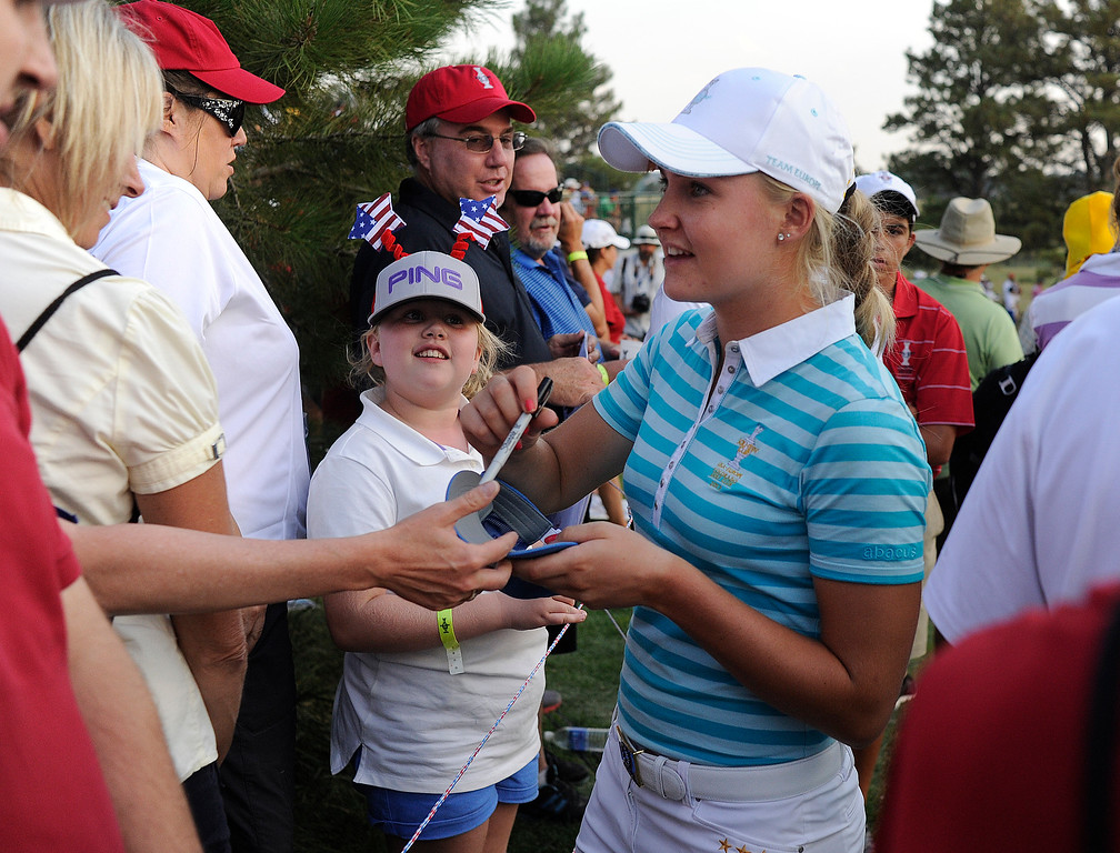 . PARKER, CO. - AUGUST 17: English golfer Charley Hull obliged fans requesting autographs on the 18th green Saturday at the Solheim Cup. It was the American Team versus the Europeans as play continued at the Colorado Golf Club Saturday afternoon, August 17, 2013. Photo By Karl Gehring/The Denver Post