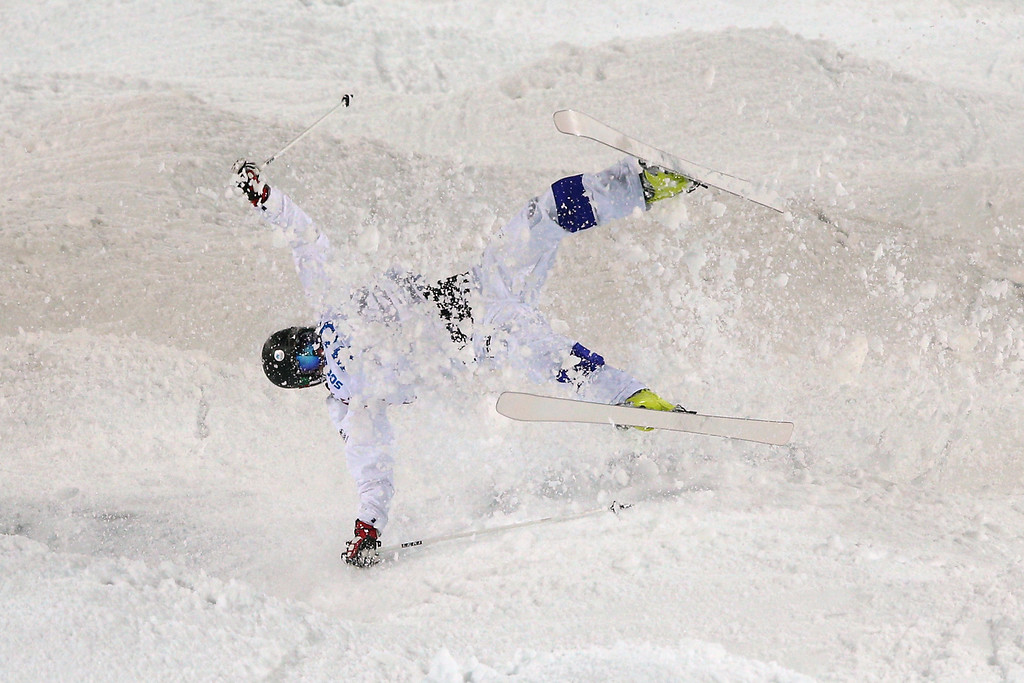 . Jussi Penttala of Finland crashes out in the Men\'s Moguls Qualification on day three of the Sochi 2014 Winter Olympics at Rosa Khutor Extreme Park on February 10, 2014 in Sochi, Russia.  (Photo by Cameron Spencer/Getty Images)