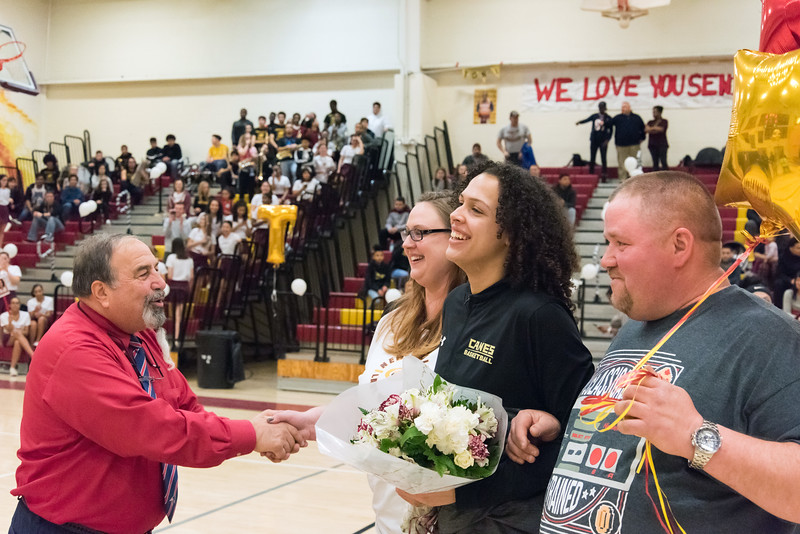02/04/19  Wesley Bunnell | Staff  New Britain basketball celebrated Senior Night on Monday evening before their game vs Plainville.  Senior Brianna Clark is escorted by her family pregame as they are greeted by Athletic Director Len Corto.