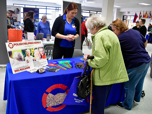 4/6/2019 Mike Orazzi | Staff Polish Helping Hand's Mariola Badzioch during the 5th Annual Connecticut Prime Time Senior Fair Saturday at Bristol Eastern High School.
