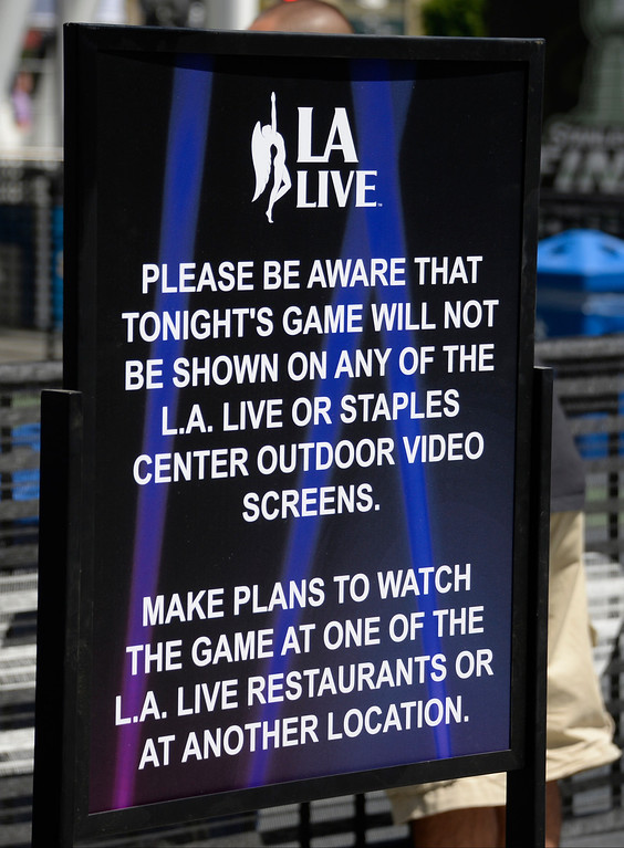 . June 13,2014. Los Angeles. CA.  A message saying that the tonights game will not be shown on the big TV screens, as thousands of LA King fans arrive hours early at Staples Center for game 5 of the Stanley Cup Playoffs. Photo by Gene Blevins/LA DailyNews