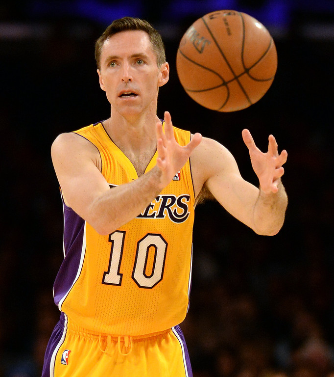 . Los Angeles Lakers guard Steve Nash passes in the first quarter during an NBA basketball game against the Dallas Mavericks in Los Angeles, Calif., on Friday, April 4, 2014.  (Keith Birmingham Pasadena Star-News)