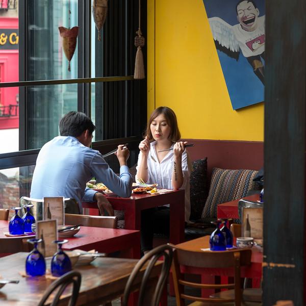 Couple eating food in restaurant, Seoul, South Korea