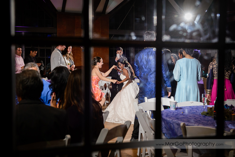 bouquet toss at indian wedding at Brazilian Room - Tilden Regional Park, Berkeley