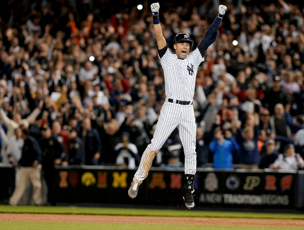 . New York Yankee Derek Jeter jumps after hitting the game-winning single against the Baltimore Orioles in the ninth inning of a baseball game, Thursday, Sept. 25, 2014, in New York. The Yankees won 6-5. It was Jeter\'s last home game of his career at Yankee Stadium.  (AP Photo/Julie Jacobson, File)