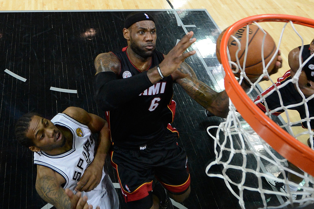 . LeBron James #6 of the Miami Heat goes up for a shot against Kawhi Leonard #2 of the San Antonio Spurs in the first half during Game Four of the 2013 NBA Finals at the AT&T Center on June 13, 2013 in San Antonio, Texas.   (Photo by Derick E. Hingle/Pool/Getty Images)