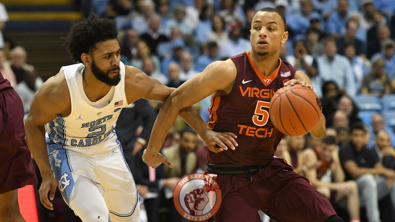 Virginia Tech Hokies guard Justin Robinson (5) drives past North Carolina Tar Heels guard Joel Berry II (2). (Michael Shroyer/ TheKeyPlay.com)