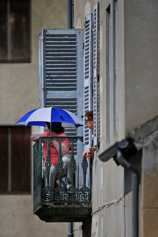 . Two elderly women watch preparations for the fourteenth stage of the Tour de France cycling race over 191 kilometers (119.4 miles) with start in in Saint-Pourcain-sur-Sioule and finish in Lyon, central France, Saturday July 13 2013. (AP Photo/Peter Dejong)