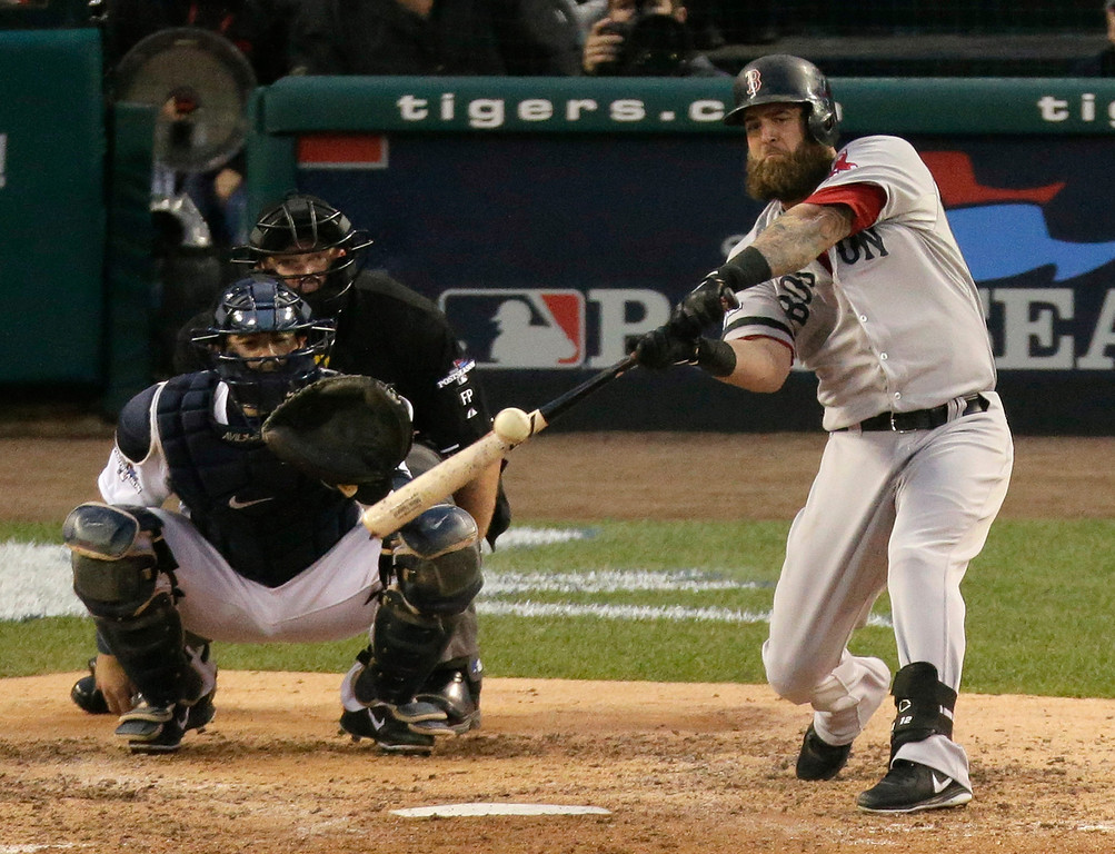 . Boston Red Sox\'s Mike Napoli hits a home run in the seventh inning during Game 3 of the American League baseball championship series against the Detroit Tigers Tuesday, Oct. 15, 2013, in Detroit. (AP Photo/Charlie Riedel)