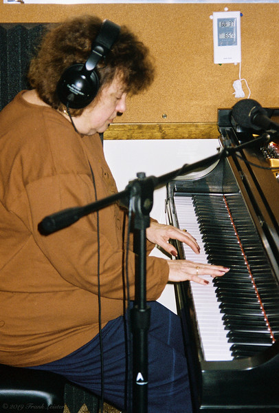 Shirley Lebin, playing the new Steinway piano, in the basement of our 702 Robert St. home in Mechanicsburg. Jan 1 1998.