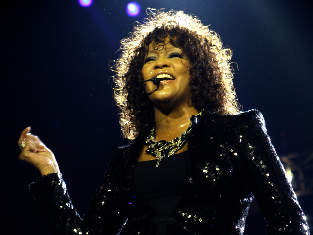 . FILE - In this April 25, 2010 file photo, singer Whitney Houston performs at the o2 in London as part of her European tour.  (AP Photo/Joel Ryan, file)
