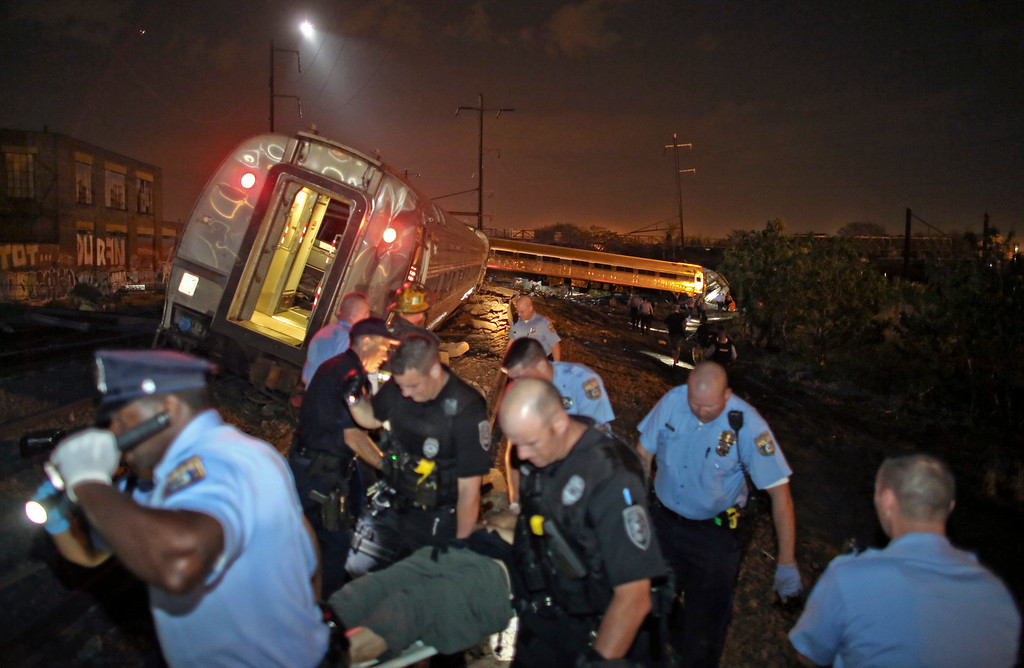 . Emergency personnel work the scene of a train wreck, Tuesday, May 12, 2015, in Philadelphia. An Amtrak train headed to New York City derailed and crashed in Philadelphia. (AP Photo/ Joseph Kaczmarek)