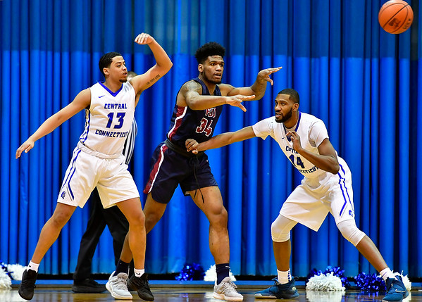 3/2/2019 Mike Orazzi | Staff CCSU's Tyson Batiste (13) and Deion Bute (14) with Fairleigh Dickinson's Mike Holloway Jr. (34) during Saturday's Mens basketball game in New Britain.
