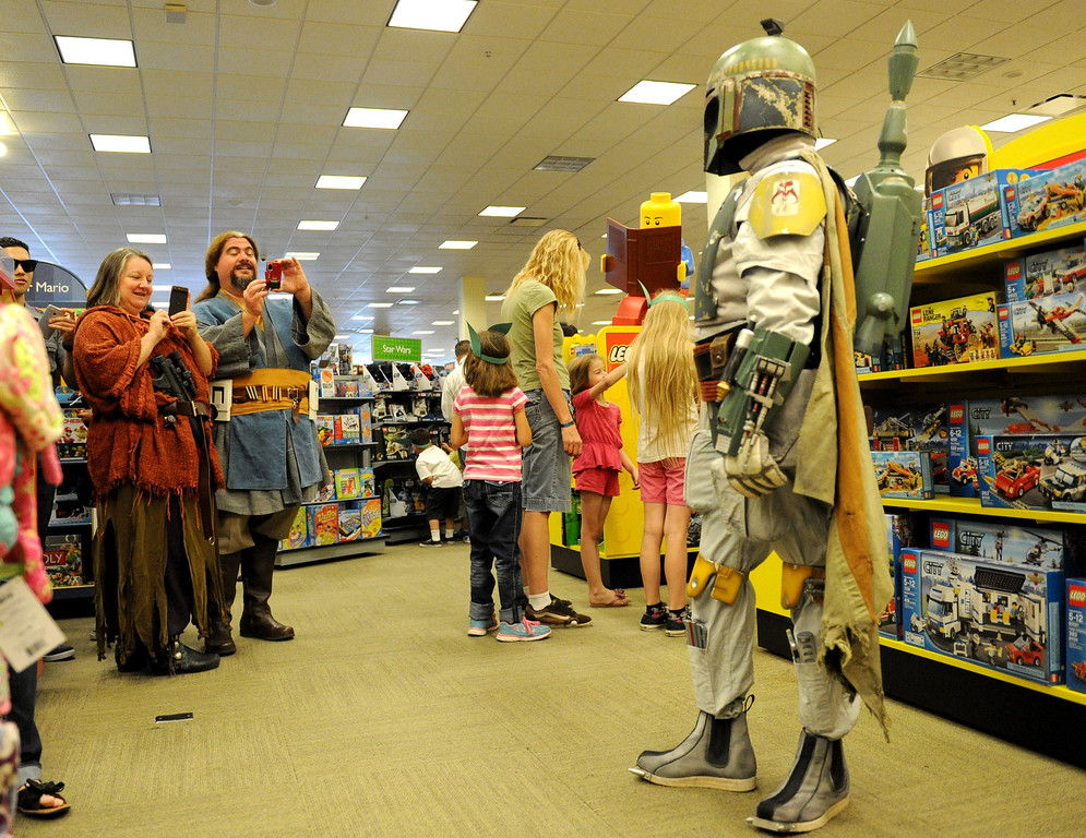 . (John Valenzuela/Staff Photographer) Margene Habermacher of Pico Riveria and Kevin Wright of San Bernardino takes pictures of Boba Fett at Barnes & Noble Bookstore in Redlands during the Star Wars Reads Day, Saturday, Oct. 5, 2013.