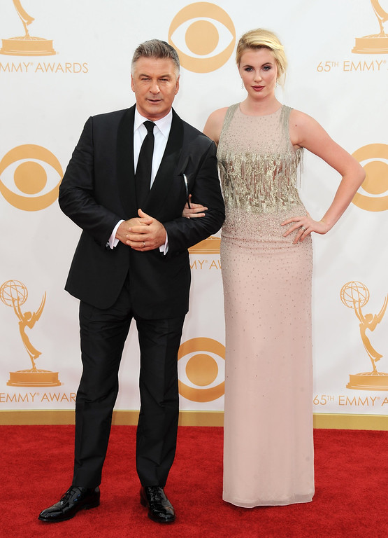 . Alec Baldwin, left, and his daughter Ireland Baldwin arrive at the 65th Primetime Emmy Awards at Nokia Theatre on Sunday Sept. 22, 2013, in Los Angeles.  (Photo by Jordan Strauss/Invision/AP)