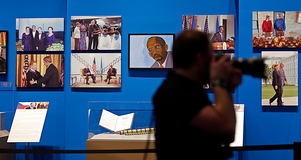 """. Paintings by former president George W. Bush are on display with photographs as part of the exhibit, \""""The Art of Leadership: A President\'s Personal Diplomacy\"""" at the George W. Bush Presidential Library and Museum on April 4, 2014 in Dallas, Texas. (Photo by Stewart F. House/Getty Images)"""