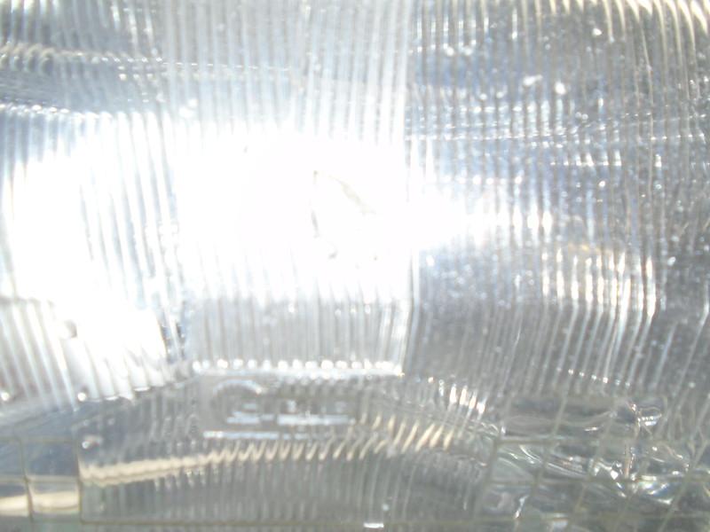 Stone-chipped o/s/f headlamp lens