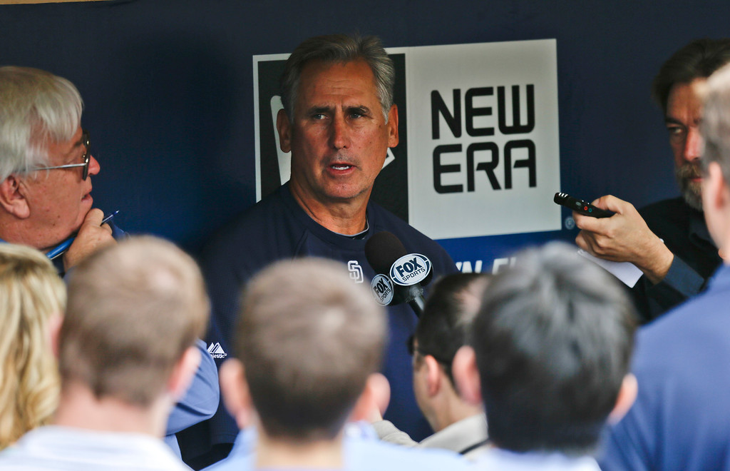 . San Diego Padres manager Bud Black, center, is surrounded by journalist during his pregame news conference, Thursday, April 11, 2013, in San Diego, before Padres\' baseball game against the Los Angeles Dodgers. (AP Photo/Lenny Ignelzi)