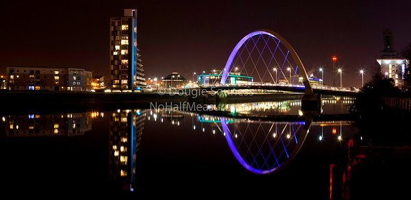 '10' - The Clyde Arc and neighbourhood reflecting in the River Clyde, Glasgow, Scotland