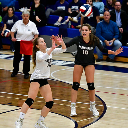 11/1/2018 Mike Orazzi | Staff Farmington High Schools Carolyn Piera (36) and Holly Picchioni (10) during the CCC Volleyball Tournament held at Avon High School Thursday night.