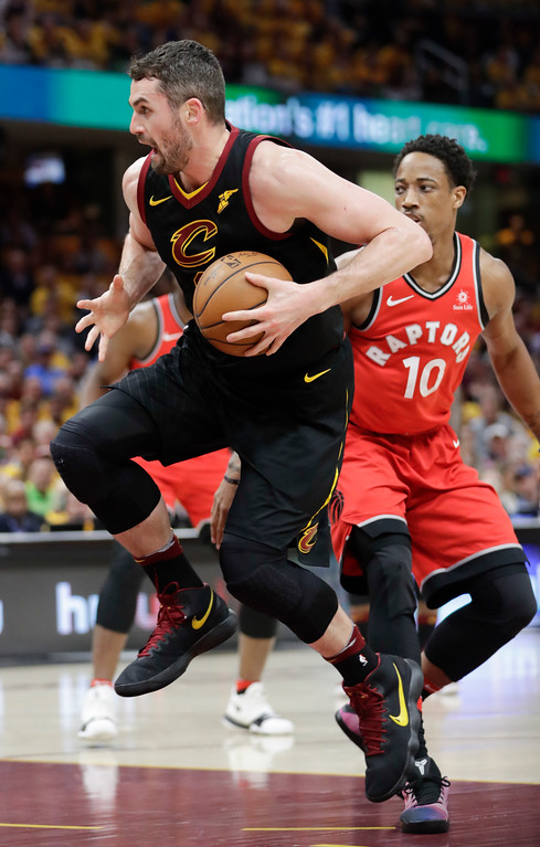 . Cleveland Cavaliers\' Kevin Love drives past Toronto Raptors\' DeMar DeRozan (10) in the first half of Game 4 of an NBA basketball second-round playoff series, Monday, May 7, 2018, in Cleveland. (AP Photo/Tony Dejak)