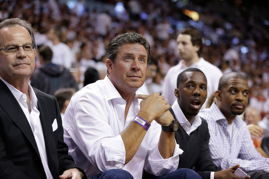 . Former NFL quarterback Dan Marino watches play between the Miami Heat and the San Antonio Spurs during the first half of Game 1 of basketball\'s NBA Finals, Thursday, June 6, 2013 in Miami. (AP Photo/Lynne Sladky)