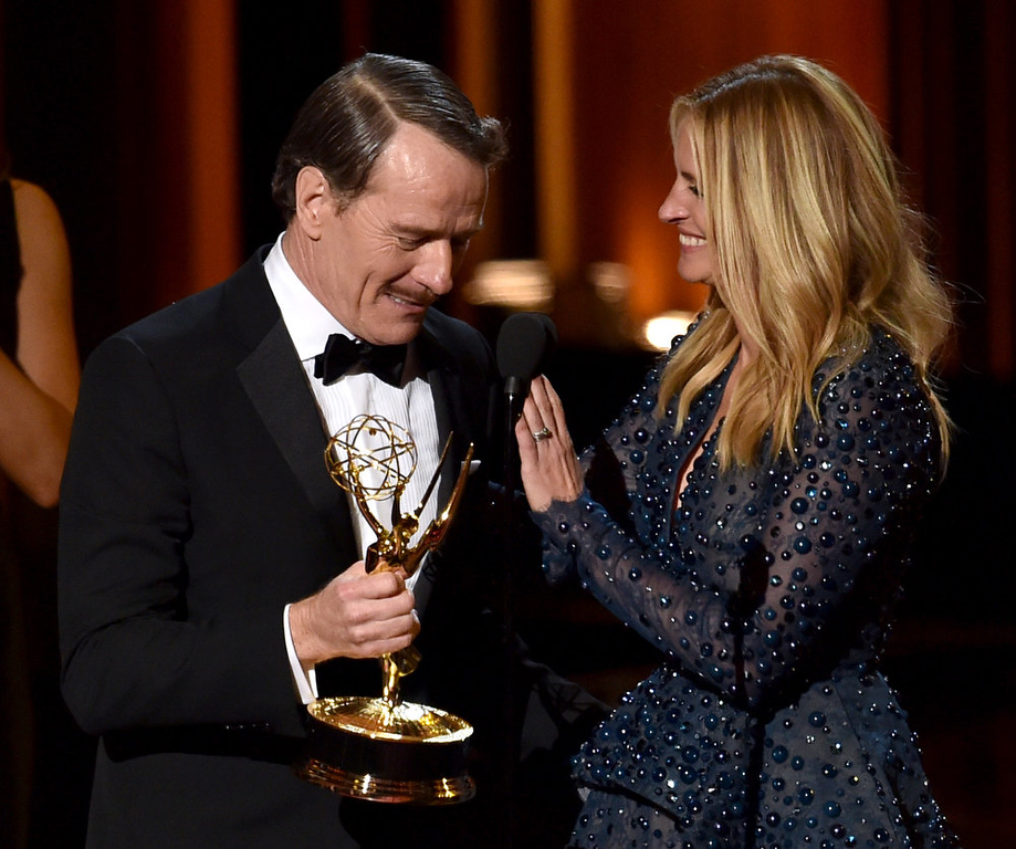 . Actor Bryan Cranston (L) accepts Outstanding Lead Actor in a Drama Series for \'Breaking Bad\' from actress Julia Roberts onstage at the 66th Annual Primetime Emmy Awards held at Nokia Theatre L.A. Live on August 25, 2014 in Los Angeles, California.  (Photo by Kevin Winter/Getty Images)